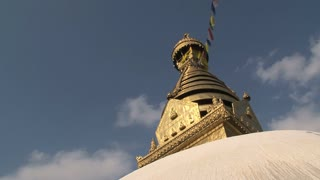 Golden top of the Swayambhunath stupa, monkey temple with prayer flags
