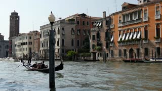 Gondela and water taxi in Venice Italy