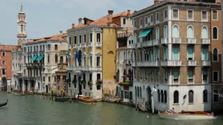 Gondola and water taxi in Venice Italy