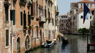 Gondola in a canal and European flag in Venice Italy