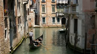 Gondola in a canal in Venice Italy