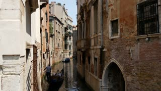Gondola in a narrow canal in Venice Italy