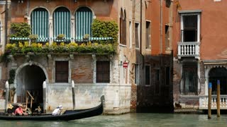 Gondola in front of a traditional house in Venice Italy