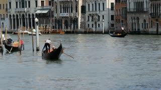 Gondolas and water taxis close to the Ponte di Rialto in Venice Italy