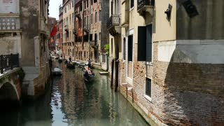 Gondolas in a canal in Venice Italy