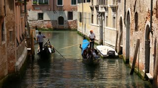 Gondolas passing by eacht other in a canal in Venice Italy