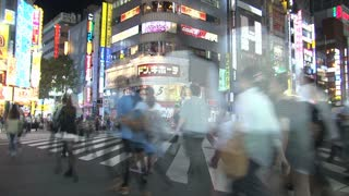 Green light to cross a pedestrain in the Shinjuku district in the evening timelapse