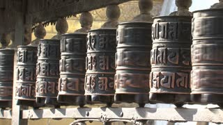 Hands touching the prayer wheels at the Monkey temple, Swayambhunath Stupa
