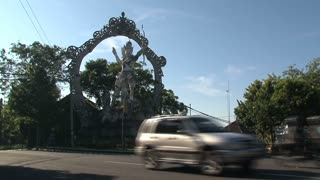 Hindu Statue and traffic in Bali