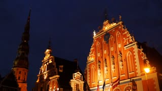 House of the Blackheads with the St. Peter's Church at the background at night in Riga Latvia