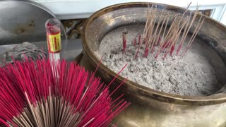 Incense at the Wat Arun a Buddhist temple in Bangkok Thailand