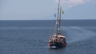Junk sailboat arriving at giola in Thassos Greece