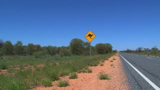 Kangaroo sign with rental car passing by