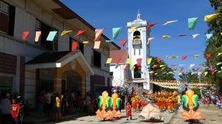 Kids santo nino parade in front of the Santo Nino de Anda Parish Church in anda bohol the Philippines