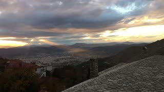 Light rays of sunshine shining over the city Volos in Greece