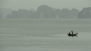 Local vietnamese fisher man fishing in a small boat in the morning