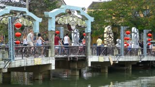 Locals and tourists at the Cau An Hoi bridge in Hoi An Vietnam