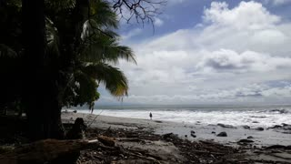 Lonely person walking at the emty beach in Montezuma Costa Rica