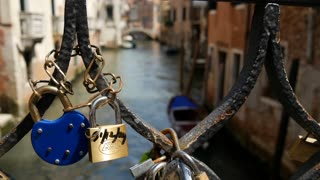 Love locks at the bridge at Campiello Drio La Pieta in Venice Italy from sharp to blur