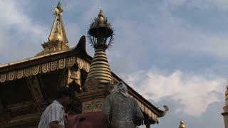Man painting a stupa at the Swayambhunath stupa, monkey temple