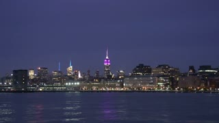 Manhattan skyline and Empire state at night, New York City, USA