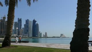 Men walking at the Corniche Promenade in Doha Qatar