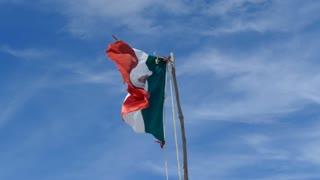 Mexican flag at Tulum beach in Yucatan, Mexico