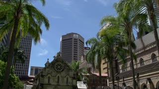 Modern skyscrapers and The Cathedral of St Stephen in Brisbane