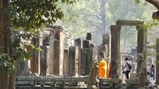 Monks at the Bayon Khmer temple at Angkor Wat Cambodia