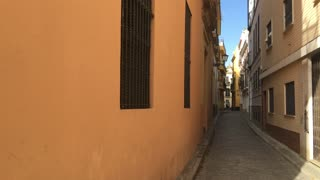 Narrow street in the old town of Seville Spain