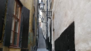 Narrow street with stairs in Gamla Stan Old town Stockholm Sweden