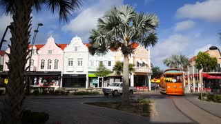 Orange tram passing by in Oranjestad Aruba