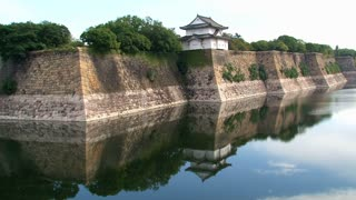Osaka castle guard house water reflection