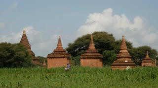 Pagodas landscape with an electro bike passing by in Bagan, Myanmar, Burma