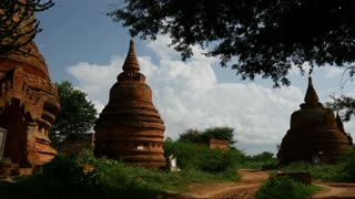 Pagodas next to a dirt road in Bagan, Myanmar, Burma