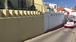 Pan from a small tourism bus train to Praia de Carvoeiro in Algarve, Portugal
