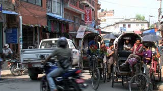 Pan from Bike taxis in the street of Kathmandu, Nepal