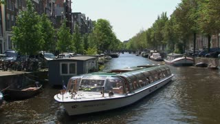 Pan from canal boat in Amsterdam