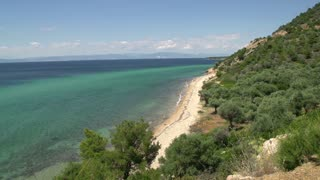 Pan from coastline and beach at Thassos island, Greece