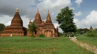 Pan from pagodas to That Byin Nyu Temple in Bagan, Myanmar, Burma