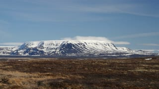 Pan from snowy volcanoes in Iceland