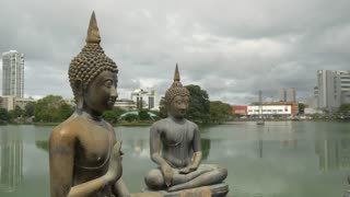 Pan from the Buddhism statues at the Simamalaka shrine, on an island in Beira Lake, Colombo, Sri Lanka