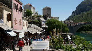 Pan from tourism to the Stari Most (Old Bridge) Mostar Bosnia and Herzegovina