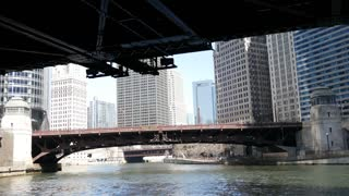 Passing by a bridge at Chicago river with a tilt to the skyscrapers