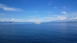 Passing by an other ferry while sailing from Paquera to Puntarenas in Costa Rica