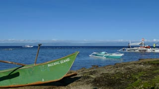 People at a Catamaran Boat in the morning at Balicasag Island in Bohol the Philippines