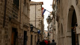 People in the streets of Dubrovnik with Croatian flag