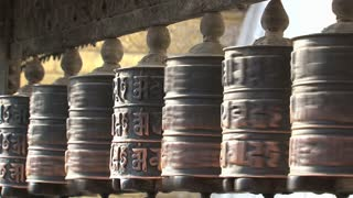 People touching the prayer wheels at the Monkey temple, Swayambhunath Stupa
