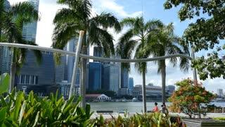 People walking an running around Marina Bay in Singapore