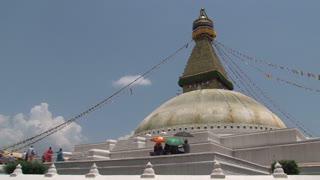 People walking around the Boudha stupa in Kathmandu, Nepal